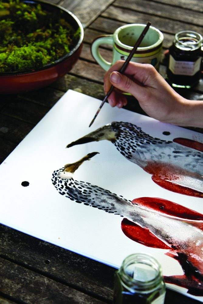 Flora Wallace painting birds with foraged inks