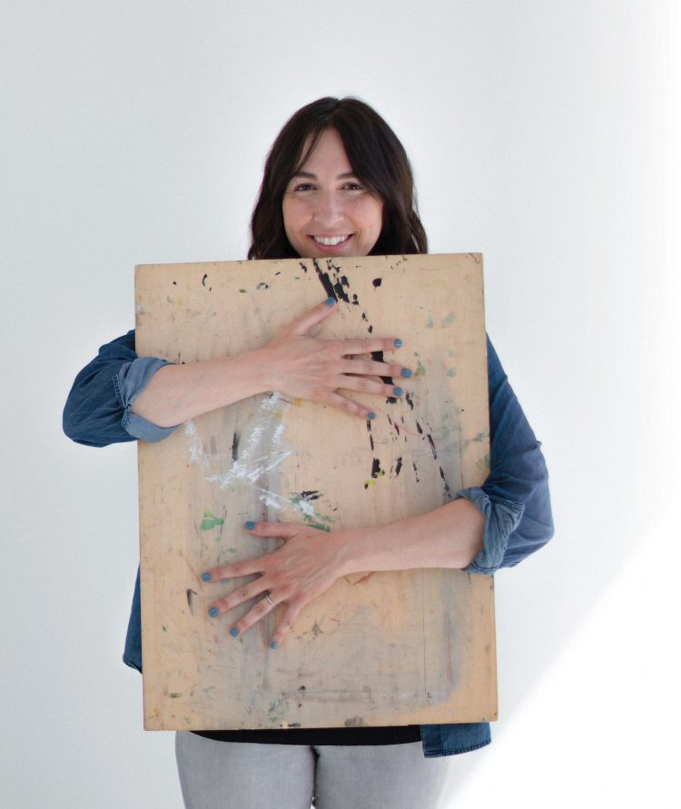 Alia Bright posing with an art board