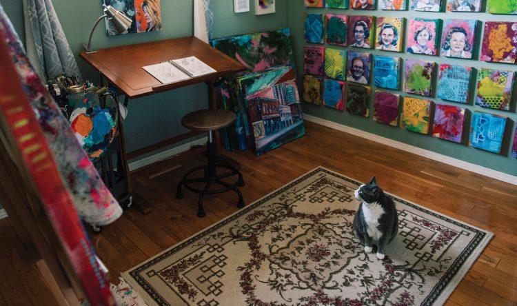 A cat sitting in the middle of Veronica Funk's studio