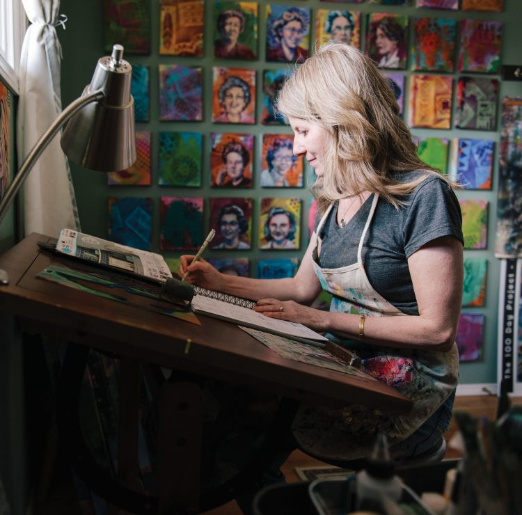Veronica Funk at her desk sketching in a notebook